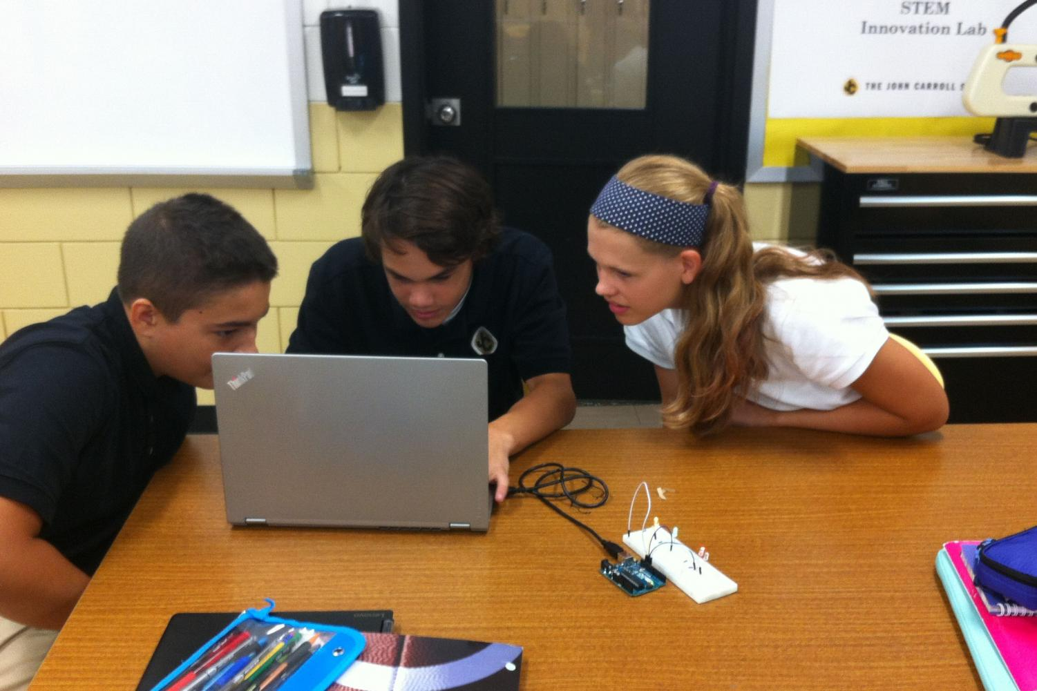 Sophomores Matt Fabiszak, Cole Jones, and Alexis Loder work on an interactive project during their STEM meeting. Having a similar program for humanities would allow students with a strength in the liberal arts to participate in a hands-on program such as this one.