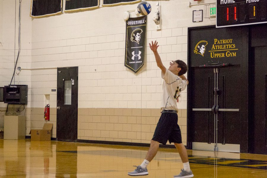 Senior opposite hitter Kyle Wedemeyer serves the volleyball in a game against Archbishop Spalding on Friday, Oct. 27. The men's varsity volleyball team finished the season with a 1-18 record.