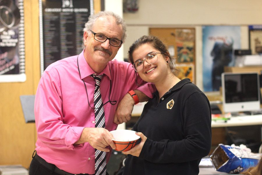 Junior Misha Noske and club moderator Robert Schick pose during their second Love One Another Club meeting of the year on Wednesday, Nov. 8. The club meets every other Wednesday after school.