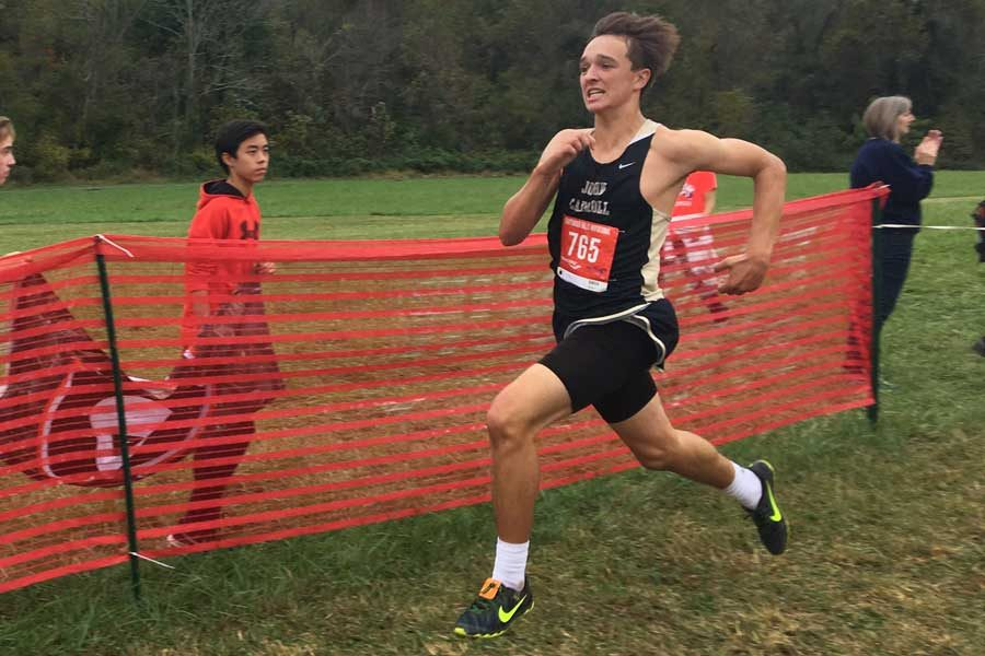 Junior Luke Dippel pushes through the race at the Gunpowder Invite on Saturday, Oct. 21. The men's varsity cross country team had an undefeated season and won the MIAA B Conference championship.