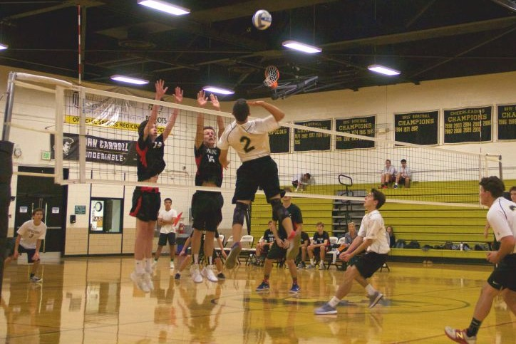 Junior outside hitter Nico Santoro jumps to spike the volleyball against Archbishop Spalding on Friday, Oct. 27. Men's varsity volleyball lost 3-2 on their senior night.