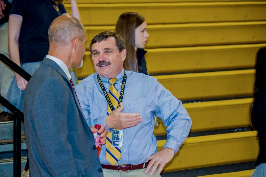 President Steve DiBiagio talks to social studies teacher and Department Chair Jake Hollin. In order to learn more about student life, DiBiagio shadowed with a student on Oct. 12.