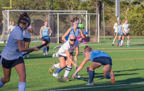 Senior Ashlee Kothenbeutel takes the ball from a Mount de Sales player on Monday, Oct. 30. The varsity field hockey team lost 2-1 in the IAAM B Conference quarterfinals.