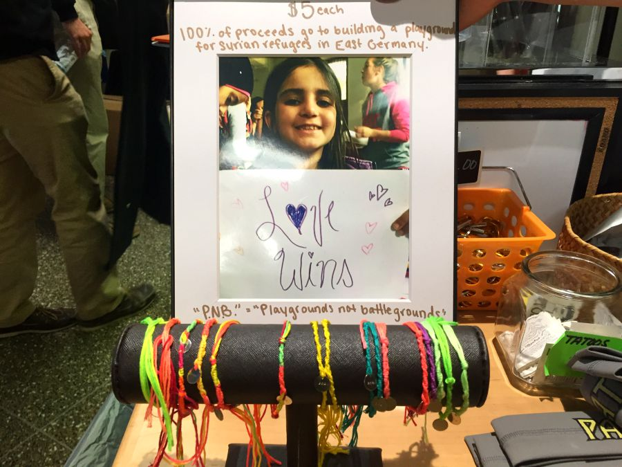 Senior Grace Hollin sells bracelets for five dollars in the school store as a fundraiser for her Senior Project. During the month of July, Hollin traveled to Bad Blankenburg, Germany to help unite the Syrians with the Germans.
