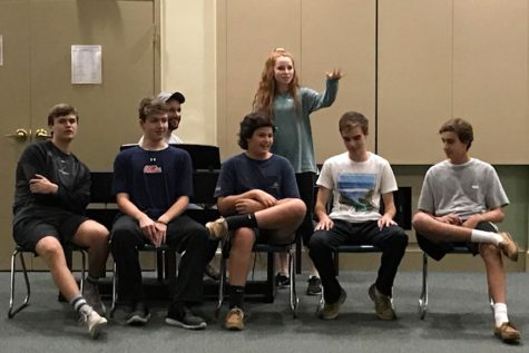Junior Lindsay Rosser sings alongside classmates during the talent show on one of the junior retreats held on Oct. 15. The overnight retreat brought students together while showcasing their individuality.