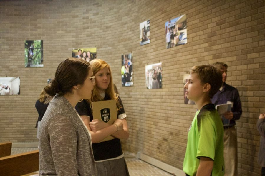 Junior Katie Scheidhauer and religion teacher Meghan Sprankle explain campus ministry to a prospective student at Open House. Open House was held on Saturday Oct. 28 from 11 a.m. to 2 p.m.
