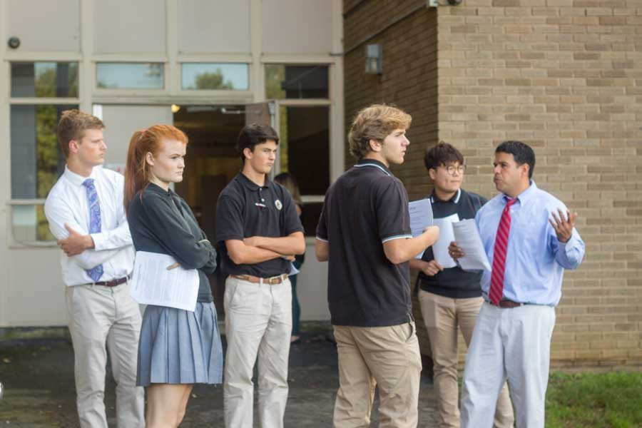 Senior Paul Diehl, senior Rosemary Gilliam, sophomore Grant MacIver, senior Bradley Hock, and senior Toby Wu (left to right) listen as Director of Enrollment Edward Maynard guides them on a mock tour in preparation for the Open House on Saturday, Oct.28. On Tuesday, Oct. 24, the Admissions Department held a training session after school.
