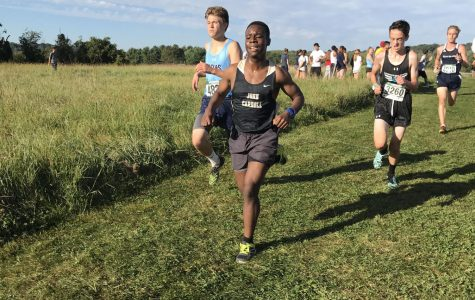 Sophomore Michael Chipi runs during a meet at Stevenson University on Saturday, Sept. 23. Varsity and JV cross country won their first MIAA B Conference championship in 28 years on Wednesday, Nov 1.