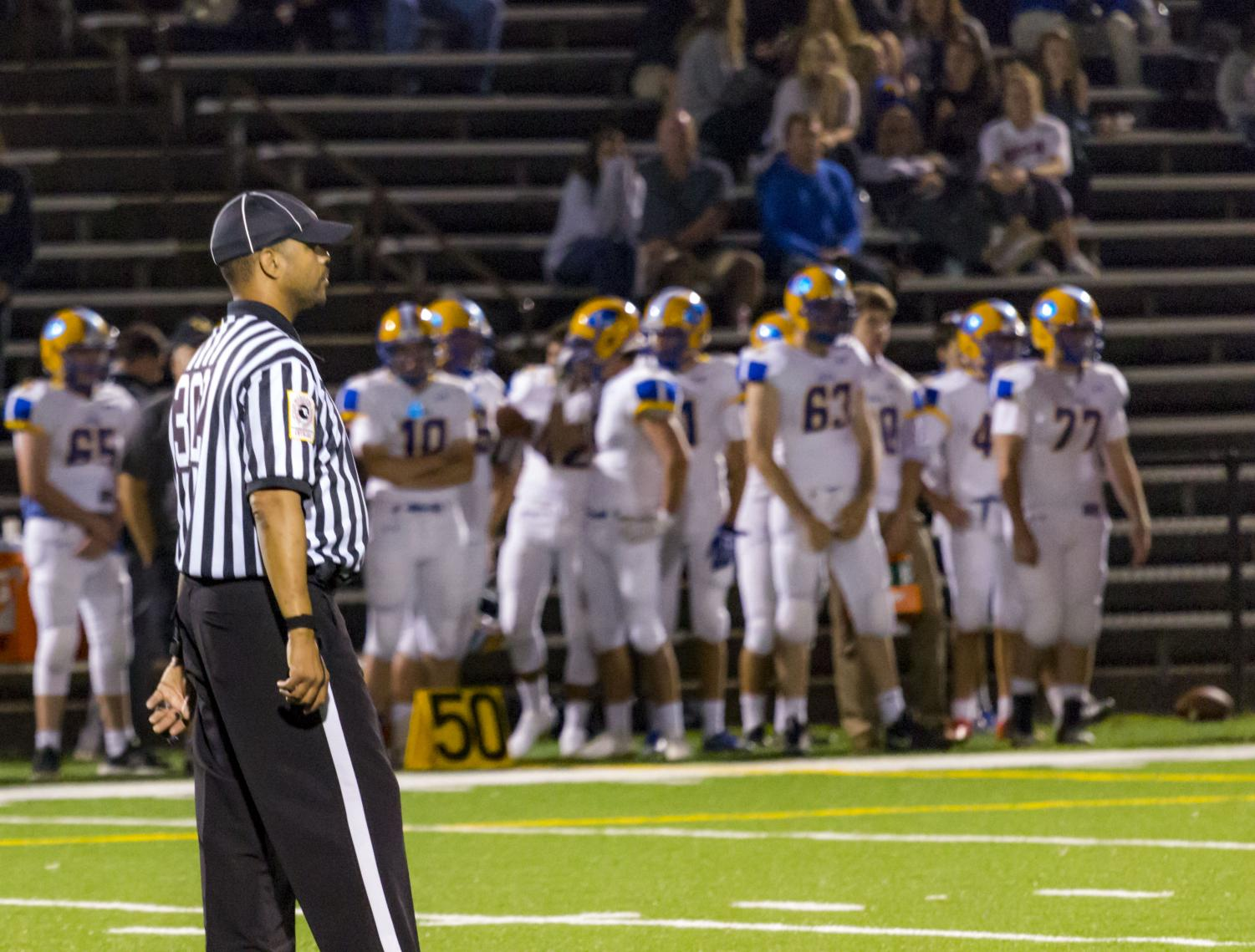 A referee focuses on a play during a JC football game versus Loyola Blakefield on Friday, Sept. 8. Every call referees make is judged by players, coaches and fans alike.