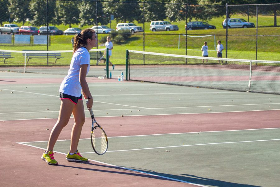 Senior Josie Cohen prepares to serve the ball in a match against Friends School of Baltimore on Tuesday, Oct. 3. The women's varsity tennis team finished their season 0-9.