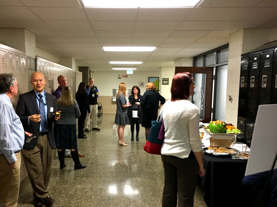 Former and current JC teachers converse and enjoy refreshments after seeing presentations on the future of science laboratories and electives.