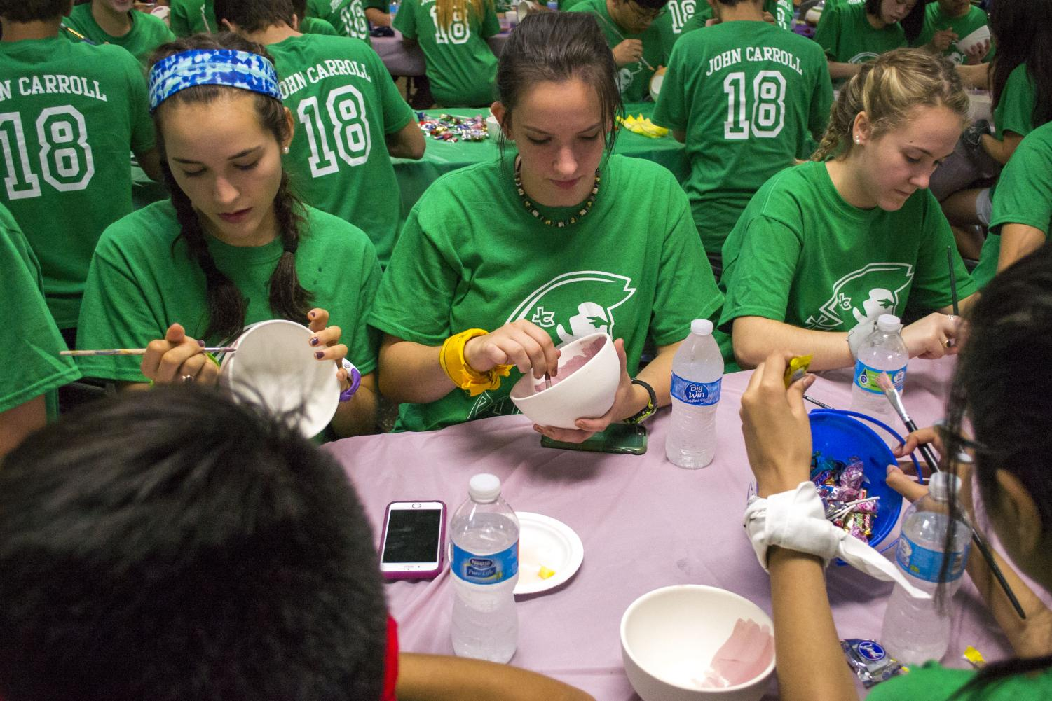 Seniors Laura Amrhein, Abby Bryant, and Caitlyn Trent paint bowls during Senior Unity Day on Friday, Sept. 22. More service opportunities should be offered where students have the opportunity to bond during the activity.