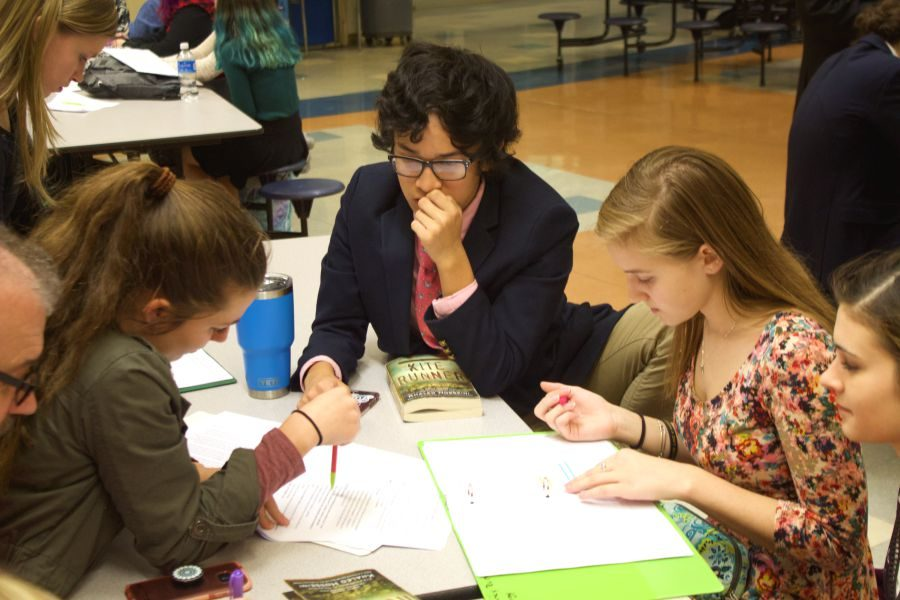 Sophomores Helen Lortie, Nik Mucha, and Delaney Runge prepare for their various events at the Speech and Debate competition at Aberdeen on Nov. 16. Lortie and Mucha placed first in Team Debate, Runge placed first in Dramatic Interpretation, and senior Laura Amrhein placed first in Children's Literature.