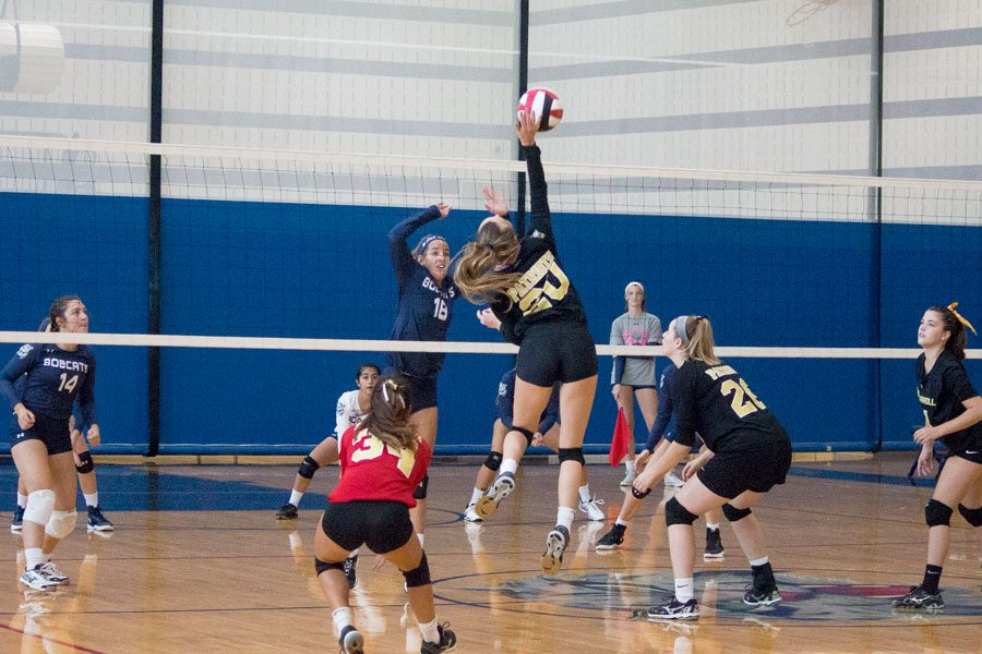 Junior outside hitter Mallory Lyon spikes the ball over the net during the women's varsity volleyball match against Bel Air. The match took place on Saturday, Sept. 16 as a part of the Battle of Bel Air.