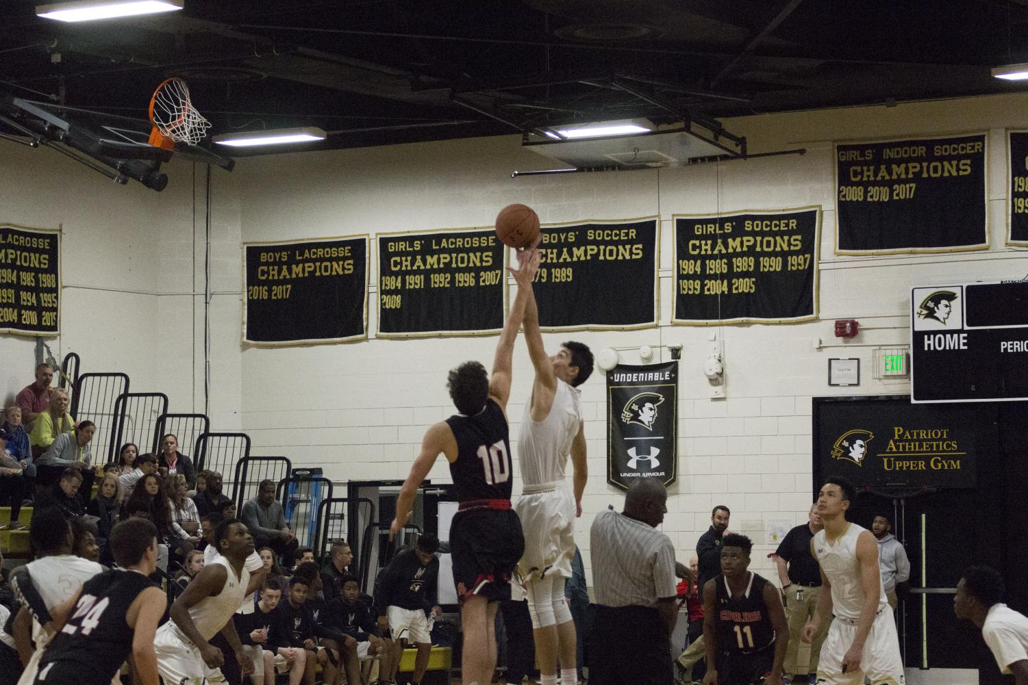 Junior Yavuz Gultekin reaches for the ball at the start of the game. On Friday, Feb. 2, the men's varsity basketball team faced the Archbishop Spalding Cavaliers and won 84-59.