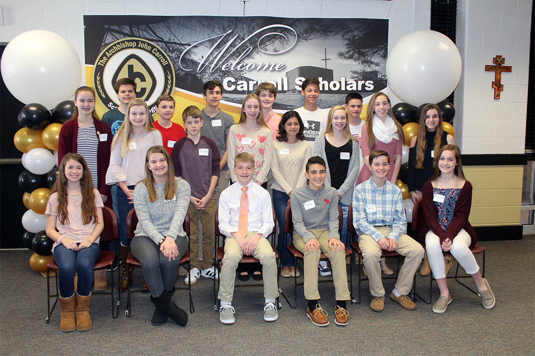 Members of the class of pose at a lunch honoring their selection into the Archbishop John Carroll Scholarship Program on Sunday, March 19. The Carroll Scholars will be a part of the AP Capstone program, the only one offered in a Maryland Catholic school.