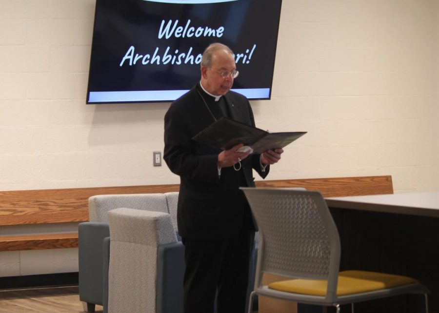 Archbishop Lori visits JC to bless areas as rain pours outside on newly-renovated courtyard