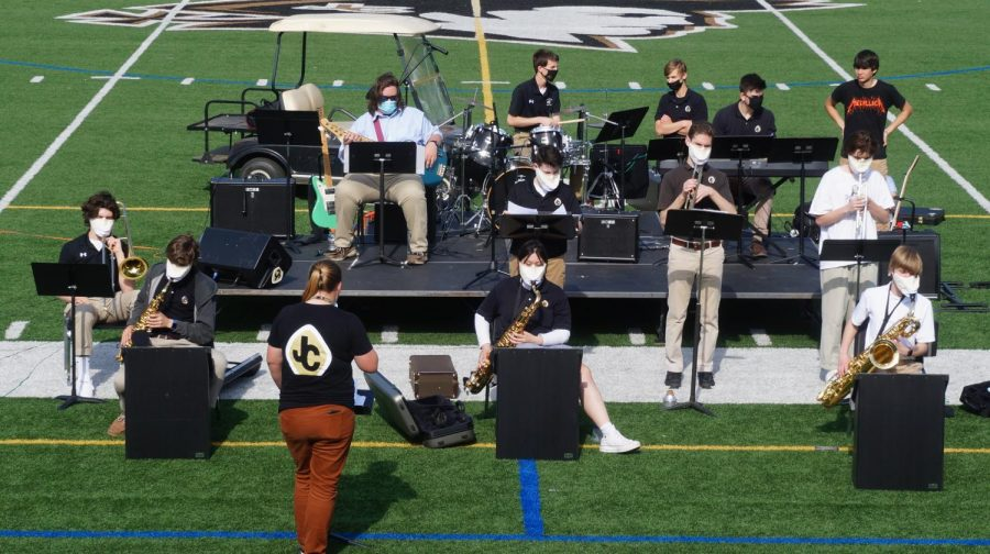 In-person spring concert begins outdoors on field
